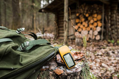 GPS navigator in the forest. Man the hunter with a GPS navigator in the forest. hunting lodge, a backpack, a gun. Technology, Gadget royalty free stock image