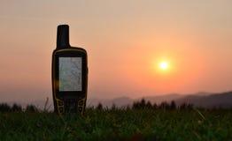 Gps navigator on grass. Gps navigator on background mountains Stock Images