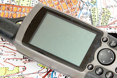 GPS Navigator portable. A GPS unit showing a color map stock photography
