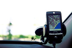 GPS navigator in vehicle. GPS navigator in vehicle with original interface. Cockpit view Stock Photo
