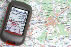 GPS and paper map. Handheld GPS and paper map Royalty Free Stock Photography