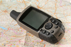 GPS receiver and a map Stock Images