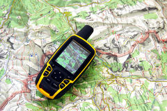 GPS receiver and map. Stock Photos