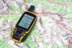 GPS receiver and map. Royalty Free Stock Image