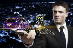 GPS and route concept. Businessman holding smartphone with abstract glowing car and location pin on night city background. GPS and route concept. 3D Rendering Royalty Free Stock Image