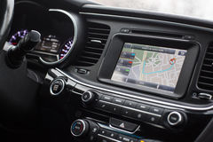 Gps with the route on the dashboard of a car. Interior Royalty Free Stock Photo