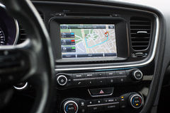 Gps with the route on the dashboard of a car. Laying out a route on a gps Navigator in the car Stock Image