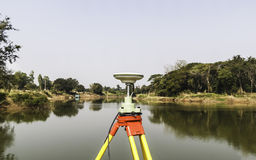 GPS surveying. Working near the river stock photos