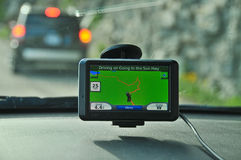GPS unit on windshield with another car Stock Image