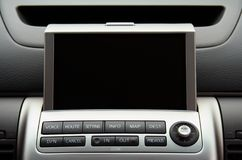 GPS vehicle navigation system. A close-up view of a GPS vehicle navigation system inside a car. Screen is blank so you can add your own stock photo