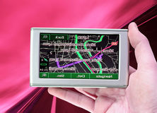GPS Vehicle navigation system in a man hand. Royalty Free Stock Photography