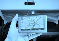 GPS Vehicle navigation system in a man hand. Royalty Free Stock Images