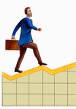 Gráfico de escalada do homem de negócio Foto de Stock Royalty Free