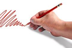 Gráfico de la mano con la pluma roja Fotografía de archivo libre de regalías
