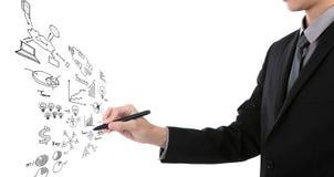 Gráfico de negócio da escrita do homem de negócios fotografia de stock royalty free