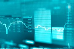 Gráfico de negócio e monitor do comércio do investimento na troca do ouro fotos de stock royalty free