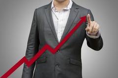 Gráfico do aumento do desenho do homem com dedo fotos de stock