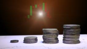 Gráfico e fileiras das moedas para o conceito da finança e do negócio vídeos de arquivo