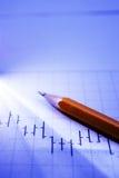 Gráfico e lápis de negócio no feixe de luz Fotografia de Stock