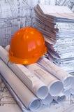 Gráficos anaranjados del casco y del proyecto Imagenes de archivo