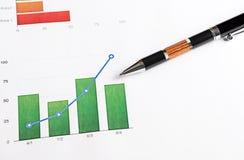 Gráficos de cor com uma pena no papel Imagens de Stock