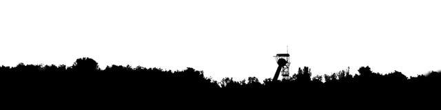 Gráficos do panorama com eixo e floresta de mina no fundo Foto de Stock