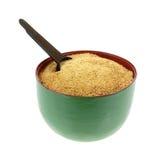 Gránulos del azúcar de la palma de coco de la cuchara del tazón de fuente Imagen de archivo libre de regalías