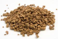 Gránulos del café instantáneo en una pila. Fotografía de archivo libre de regalías