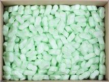 Gránulos protectores plásticos de la bruja de la caja de cartón Imagen de archivo libre de regalías