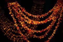 Grânulos ambarinos no mercado Fotos de Stock Royalty Free