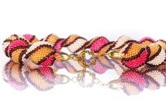 Grânulos, beadworks no branco Fotografia de Stock