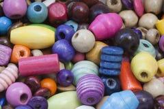 Grânulos de madeira coloridos Imagem de Stock