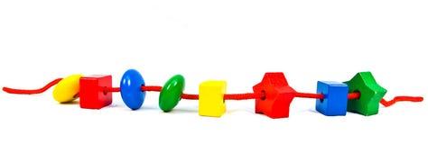 Grânulos de madeira do brinquedo Imagens de Stock