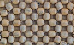 Grânulos de madeira em um fundo de madeira da tabela Fotografia de Stock