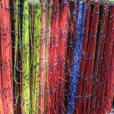 Grânulos do olho amarrados em laços coloridos Fotografia de Stock