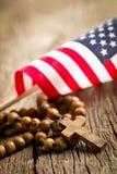 Grânulos do rosário com bandeira americana Imagem de Stock