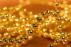 Grânulos dourados Fotografia de Stock