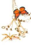 Grânulos dourados com borboleta Foto de Stock Royalty Free