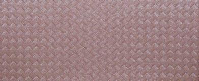 Gräns - rosa färgtextur med en vävd modell av fyrkanter med band Royaltyfria Bilder