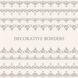 Gränser ställde in samlingen i calligraphic retro stil på beige bakgrund Fotografering för Bildbyråer