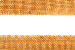 Gränstygtextur av sönderriven linne som plundrar torkduken, riven sönder kantnolla Arkivbild
