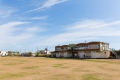 Gräsmattor Devon UK för Teignmouth sjösidastrand arkivbild