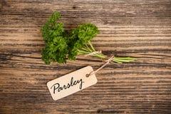 Parsley med etiketten royaltyfri fotografi