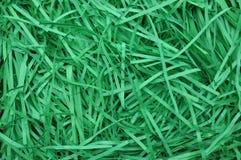 Gräsplan strimlat papper som bakgrund Royaltyfri Bild