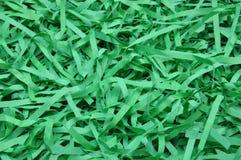Gräsplan strimlat papper som bakgrund Royaltyfria Foton