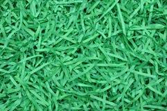 Gräsplan strimlat papper som bakgrund Royaltyfria Bilder