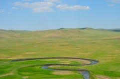 Grässlätt på Inner Mongolia Arkivbilder