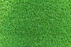 Grästexturbakgrund för golfbana, fotbollfält eller sportbegreppsdesign Konstgjort grönt gräs fotografering för bildbyråer
