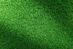 Grästexturbakgrund för golfbana, fotbollfält eller sportbegreppsdesign Konstgjort grönt gräs arkivfoton