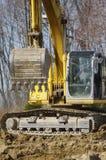 grävskopa royaltyfri bild
